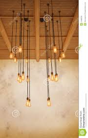 hanging ceiling lights ceiling light bulb hanging on pine wood against warm tone of gru