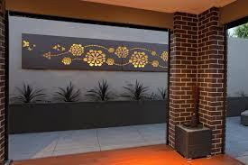 outdoor living area with feature wall art u0027flower wave u0027 custom