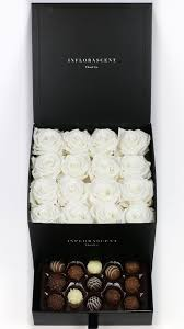 black square of infinity with white roses and chocolates