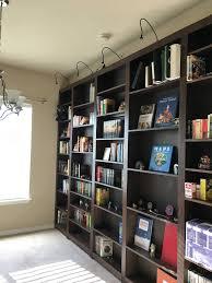 built in bookshelf wall with a hidden door album on imgur
