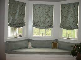 bedroom grey fabric window blinds connected by glass windows and