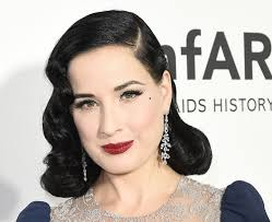 dita von teese literally dresses up as a