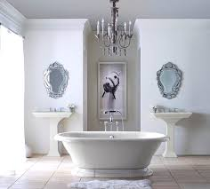white bathroom with traditional chandelier bathroom light fixtures