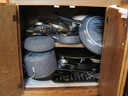 how to organize pots and pans in cabinet napo michigan where do the pots lids and pans go three