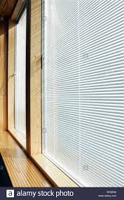 energy efficient timber windows with integral blinds stock photo
