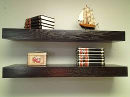 decor hardwood floating bookshelves with small wall decors and