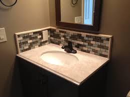 decorating small bathroom design with omicron granite countertop