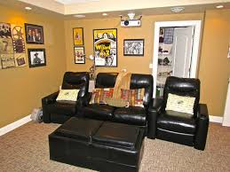 basement media room living space design with black leather sofa