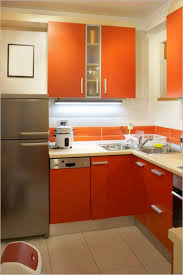 red pendant lights for kitchen light brown varnish counter top small kitchen design red cylinder