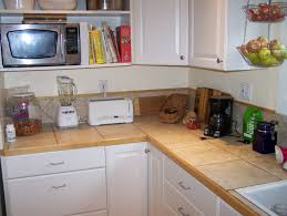 Microwave In Kitchen Cabinet by Ceramic Countertop On White Kitchen Cabinet With Hanging Cabinet