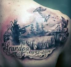 stunning memorial themed black and gray style shoulder tattoo of