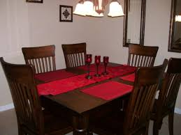 red table line and pretty glass as table pads for dining room