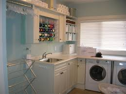 basement laundry room idea with pretty yellow wall also