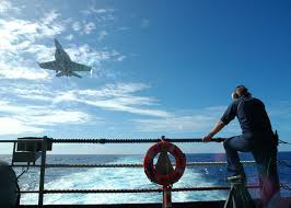 Photos of f 18 hornets taking off aircraft carrier vfa 27 on