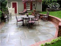 flagstone patio i like how this is edged fence deck u0026 patio
