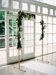 wedding backdrop stand rental diy copper piping ceremony backdrop with greenery see