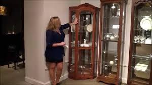 ashley furniture corner curio cabinet cherry corner curio cabinet by pulaski furniture home gallery