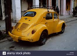 yellow volkswagen beetle royalty free classic volkswagen beetle car havana cuba stock photo royalty