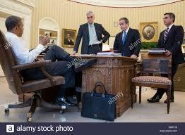 White House Oval Office Desk by Us President Barack Obama Talks With Senior Advisors In The Oval