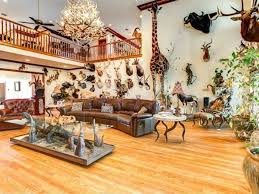 this gretna home is filled with taxidermy including a giraffe