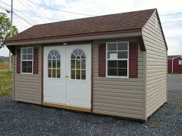 clay siding brown roof and burgundy shutters with white trim