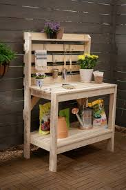 diy wood potting bench with storage and hanging planters for small