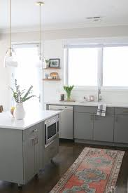grey kitchen cabinets with white countertop white gray kitchen with brass hardware the diy playbook