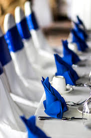royal blue chair covers event banquet table with napkins and chair covers stock photo