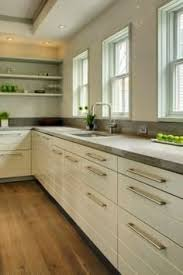 10 Beautiful Kitchens With Glass Cabinets 15 Stunning Gray Kitchens Gray Kitchens Kitchens And Gray