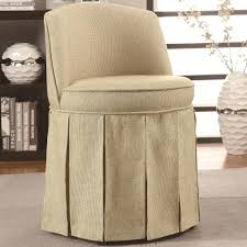 slipcovered swivel vanity chair with upholstered back and seat