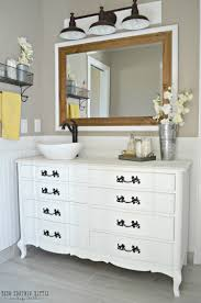 dresser made into bathroom vanity of featuring rectangular