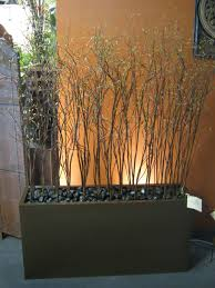 willow branches and river rock in planter boxes for deck decor i