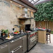 stunning stone layers outdoor kitchen space features brown wooden
