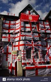 terraced house in liverpool covered in bunting and england flags