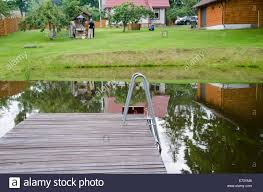 yard bridge rural pond with large plank bridge on village yard background