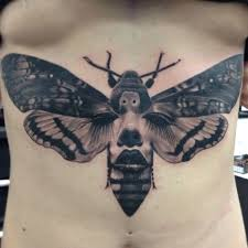 black and white moth on stomach tattoos pm