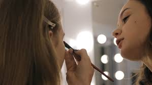 professional makeup and hair stylist professional makeup artist and hairstylist creates a beautiful