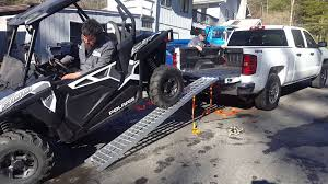 jeep bed in back loading polaris rzr 900 into standard bed pickup using a winch
