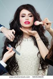 professional makeup and hair stylist professional hair stylist makeup artist doing stock photo