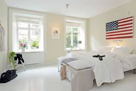 Floor Mirrors For Bedroom by White Minimalist Bedroom With White Bedding And Floor Mirror