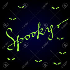 green halloween background spooky calligraphic lettering on dark blue with evil green eyes