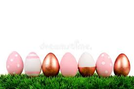 pink easter eggs easter eggs on grass isolated gold pink and white stock