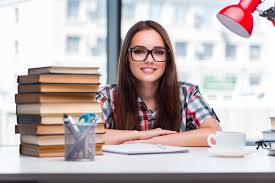 Picture Of Student Sitting At Desk A Young Female Student Sitting At The Desk Hd Picture Education