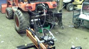 harbor freight 3 point log splitter attached to a kubota bx 24