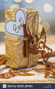 write white paper material gold wrapping paper gold ribbon metal angel white material gold wrapping paper gold ribbon metal angel white paper gold marker procedure crumpled wrapping paper and flatten again gift wrap and tie a