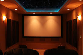 home theater with modern tiered ceiling with led lights some