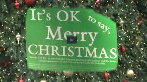 it s ok to say merry signs are popping up again