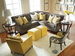 l grey fabric couch with yellow cushions added by double square