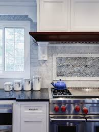 subway tile backsplashes pictures ideas tips from hgtv a wall of marble subway tile forms into a framed blue and brown