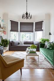 bay window desk furniture pattern rug with round sofa for bay window in grey also